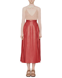 Gucci Net Tulle Top with Floral Brooch & Pleated Leather Skirt
