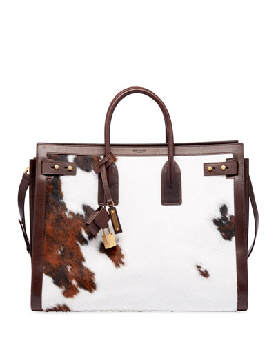 3fbea00f5417a Men s YSL Tote Bag in Cow Print Quick Look. Saint Laurent