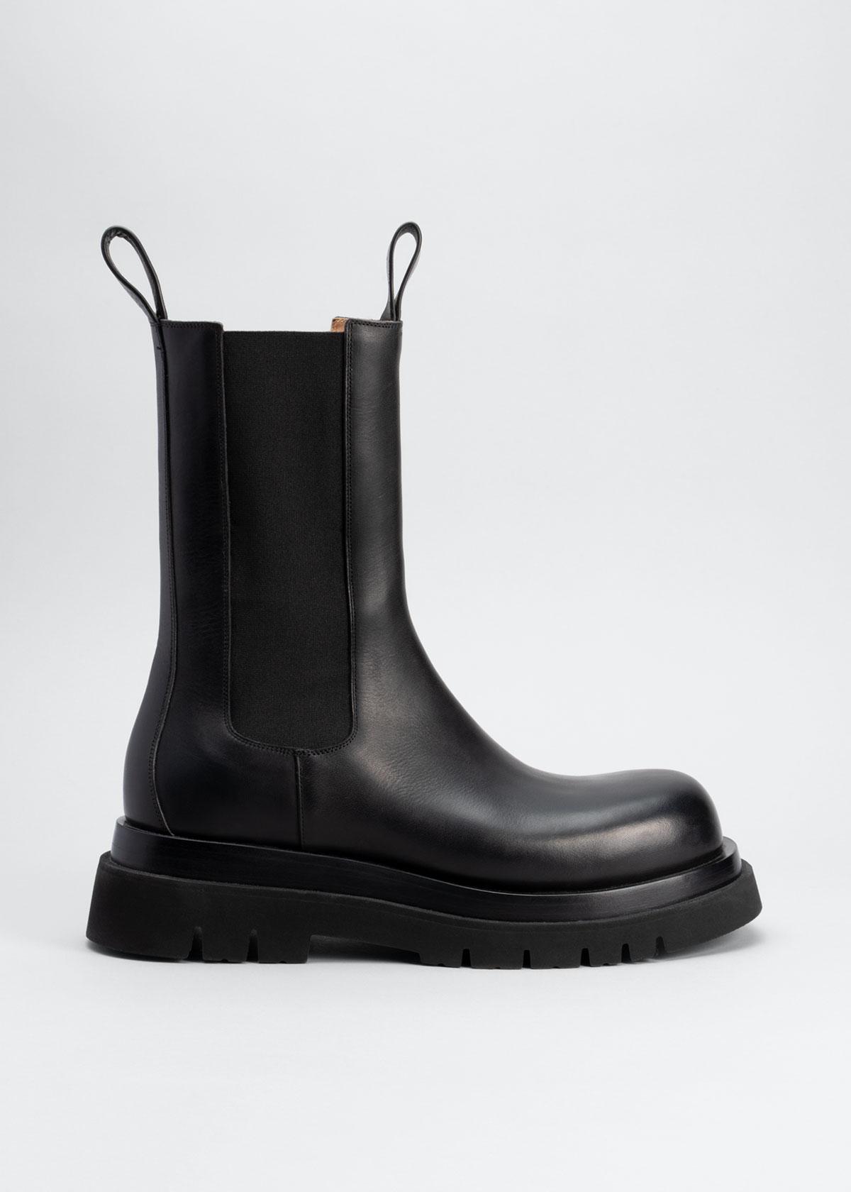 Flat Chelsea Combat Boots by Bottega Veneta, available on modesens.com for $990 Mila Kunis Shoes Exact Product