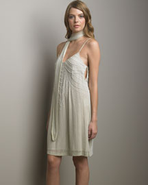 • Silk Chiffon Dress: V neckline; adjustable spaghetti straps (see below). Allover beading. Side closure. 