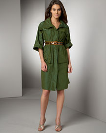 Taffeta Coat: Bottle green. Stand collar; zip/snap placket. Cuffed three-quarter sleeves. Flap detail across bust. Cargo pockets. Pure silk taffeta. Made in USA. 