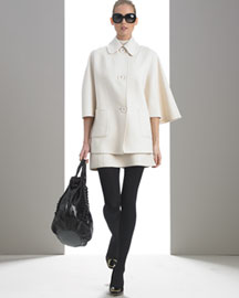 Cashgora Cape Coat: Shirt collar; button front. Three-quarter cape sleeves. Front patch pockets.