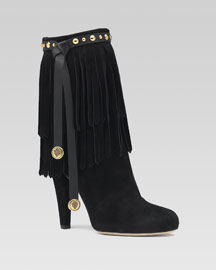 Devendra high heel bootie in black suede with Gucci crest ornaments, fringe detail, and studs. 4 1/10
